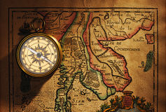Old brass compass over antique Thailand map royalty free stock photography