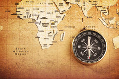 Old brass compass on a Treasure map Royalty Free Stock Photo