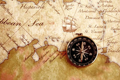 Old brass compass on a Treasure map Stock Image