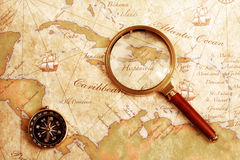 Old brass compass on a Treasure map Stock Photos