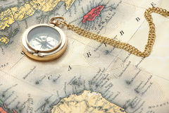 Old brass compass on the vintage map Royalty Free Stock Photo