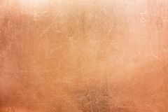 Vintage bronze texture, background of old metal plate. Old brass or copper background, texture of a vintage orange metal plate Royalty Free Stock Photos