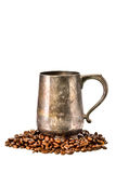 Old brass cup and coffee beans on white background Stock Photos
