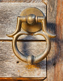 Old brass door handle Royalty Free Stock Photo
