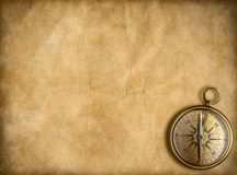 Old brass or golden compass with vintage map stock photos