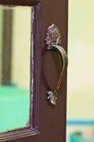 Old brass handle. On dark wood door Royalty Free Stock Photography