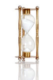 Old brass hourglass. With a reflection royalty free stock photography