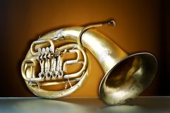 An old brass instrument. 1 royalty free stock photography