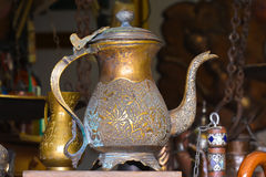 Old brass kettle, artfully decorated with stamping.  Royalty Free Stock Image