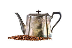 Old brass kettle and coffee beans on white background Stock Image