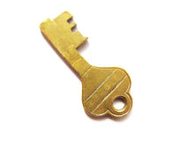 Old Brass Key. An old brass key isolated on white background royalty free stock photos