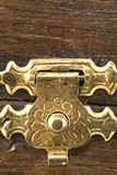 Old brass lock background. Old brass lock set against varnished wood background Royalty Free Stock Photo