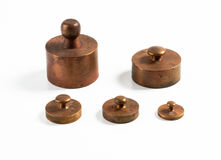 Old brass metric weights. Old metric weights made of brass stock photo
