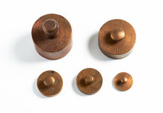 Old brass metric weights. Old metric weights made of brass royalty free stock image