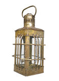Old brass oil lantern isolated. Old portable brass ship's kerosene oil lantern.  Isolated on white Royalty Free Stock Photography