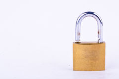 old brass padlock or master key on white background tool isolated Stock Photography