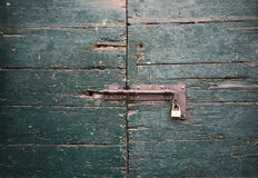 Old Brass Padlock on Wooden Green Gate Royalty Free Stock Photos