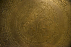 An old, brass plate. Stock Image