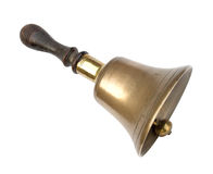 Old brass school bell, isolated on white. Traditional design, wooden handle. Well worn Stock Photo