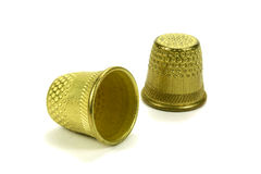 Old brass thimbles for sewing on a white background Royalty Free Stock Photos