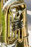 Old brass tuba mechanism. worn valves bass tuba. Stock Photos