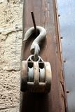 Old braun pulley on the wall Royalty Free Stock Photos