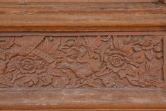 Old brawn carving wooden wall Royalty Free Stock Image