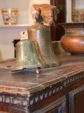 Old brazen bells over wooden table Stock Image