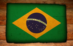 Old Brazilian flag on antique wood backdrop Stock Photo