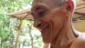 Old Brazilian man laughing, South America stock footage