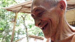 Old Brazilian man laughing, South America stock video