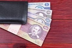 Old Brazilian money in the black wallet Stock Image