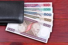 Old Brazilian money in the black wallet Stock Photo