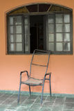 Old Brazilian rustic chair and window Stock Photos