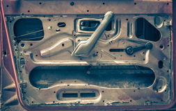 Old break up door of a car used as background. Stock Images