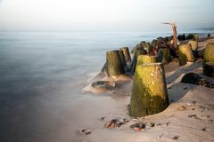 Breakwater in sea long exposure Royalty Free Stock Photo