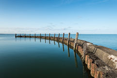 Old breakwater on a windless day Royalty Free Stock Images