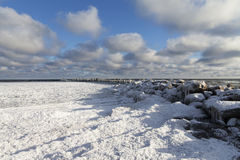 Old breakwater in winter. Royalty Free Stock Images