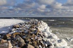 Old breakwater in winter. Stock Photos