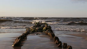 Old breakwaters go to sea stock video footage