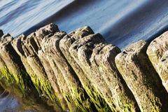 Old breakwaters in the sea in Kolobrzeg Stock Photos
