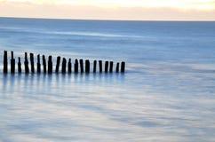 Old breakwaters. Old wooden breakwaters on tne Baltic Sea stock photos