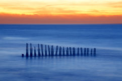 Old breakwaters. Old wooden breakwaters on tne Baltic Sea Stock Images