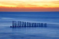 Old breakwaters. Old wooden breakwaters on tne Baltic Sea stock images