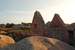 Ruined stone house at Pink Granite coast in Brittany. Old bretonhouse. Côte de Granit Rose is one of the most beautiful stretches of Brittany's stock images
