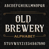 Old brewery alphabet vector font. Type letters and numbers. Stock Images