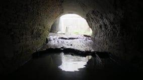 Old brick abandoned semicircular drainage tunnel