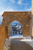 Old brick arch and stone wall as part of a medieval castle in to Royalty Free Stock Images