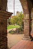 Old cloisters in San Juan Capistrano mission. Old brick arches around the cloisters of the Mission at San Juan Capistrano, California Royalty Free Stock Photo