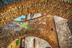 Old brick arches in San Gimignano. Italy Royalty Free Stock Image